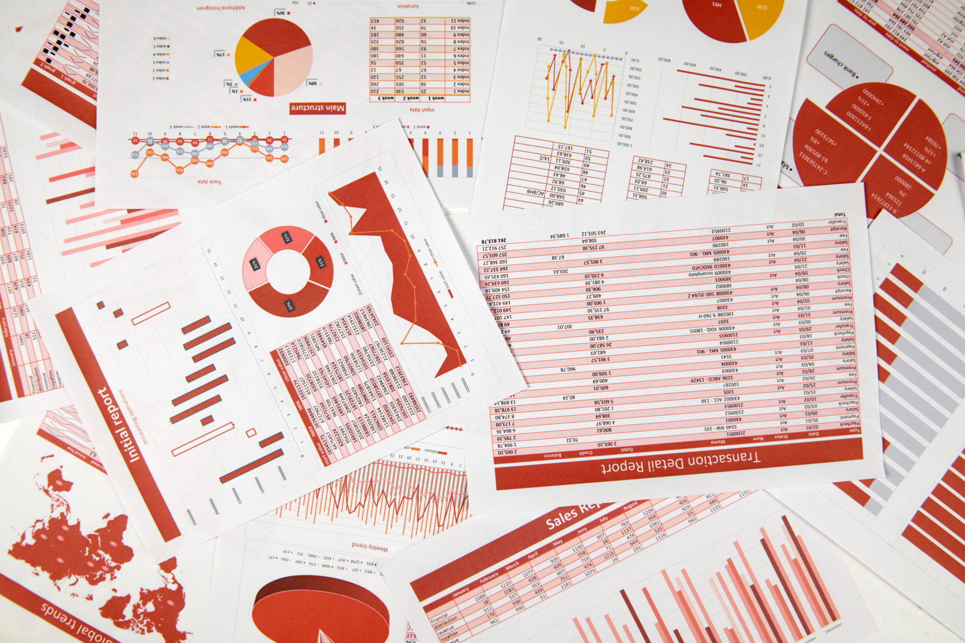 Flat top view of business workspace - reports with data, tables and analytic chart. Business financial accounting concept.
